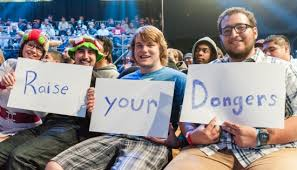 "Live Audience at the LCS Studio in California holding up signs with ""Raise your Dongers"""