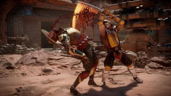 In-game footage from a Mortal Kombat fight between Raiden and Scorpion